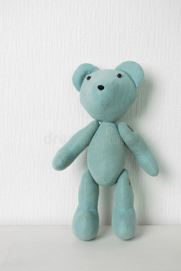 Teddy bear on a white wall background. With space for text royalty free stock photography