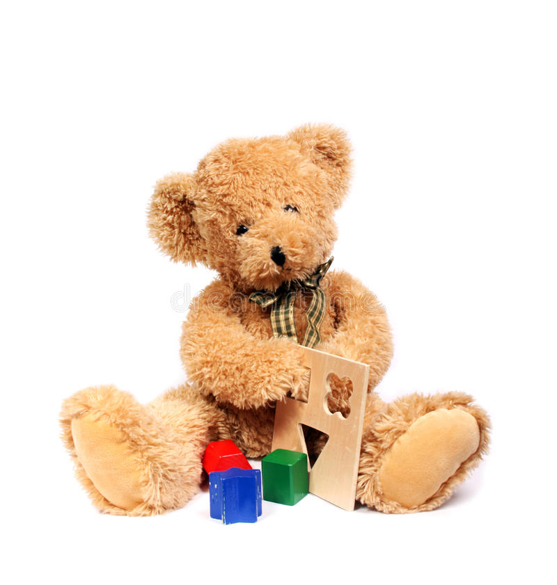 Teddy bear with wooden toys stock images