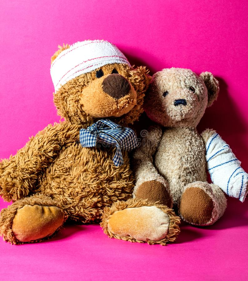Teddy bears for child friendship at hospital or domestic abuse. Concept of child friendship at the hospital with two ill teddy bears together and bandage for stock photos