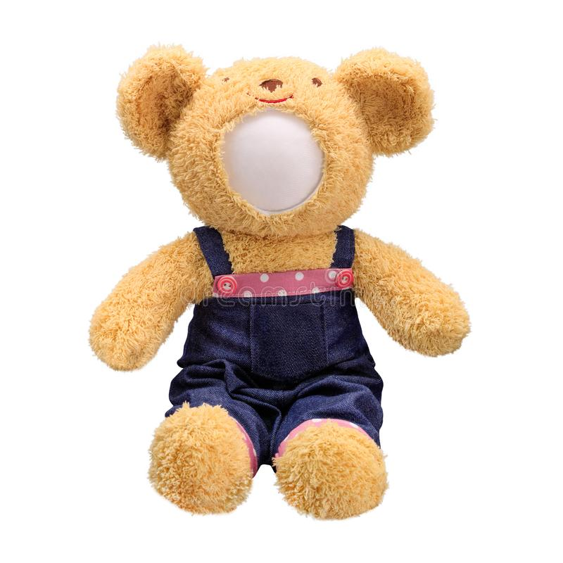 Teddy bears doll isolated on white background. Bear`s doll in blue jeans uniform. Blank face toy for design. Doll stock image