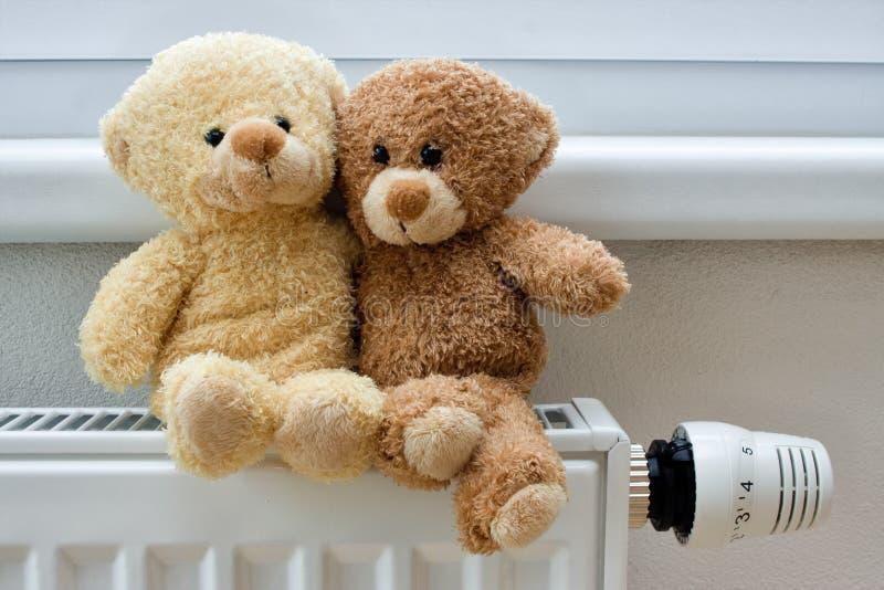 Teddy bears on the heater royalty free stock photo