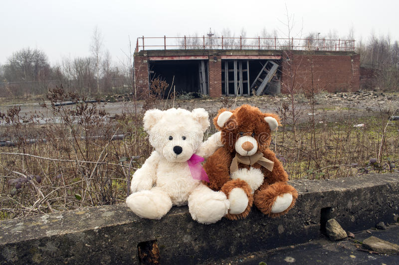 Teddy Bears Sitting In Abandoned Fire Station Yard. Teddy Bears Sitting In Derelict Abandoned Fire Station Yard royalty free stock photo