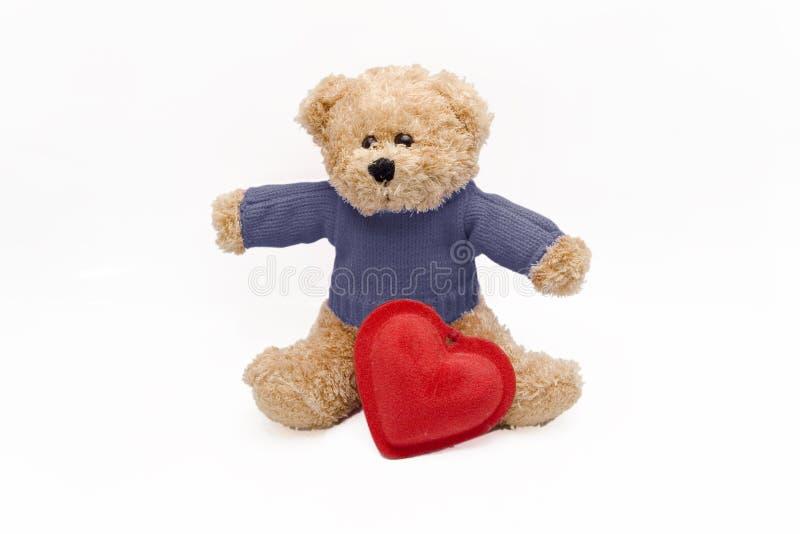Teddy en hart stock foto's
