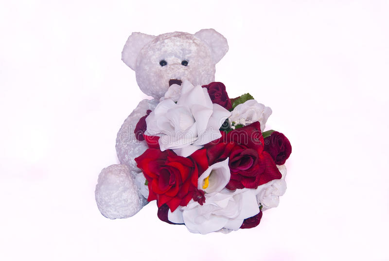 Teddy and silk flowers royalty free stock photography