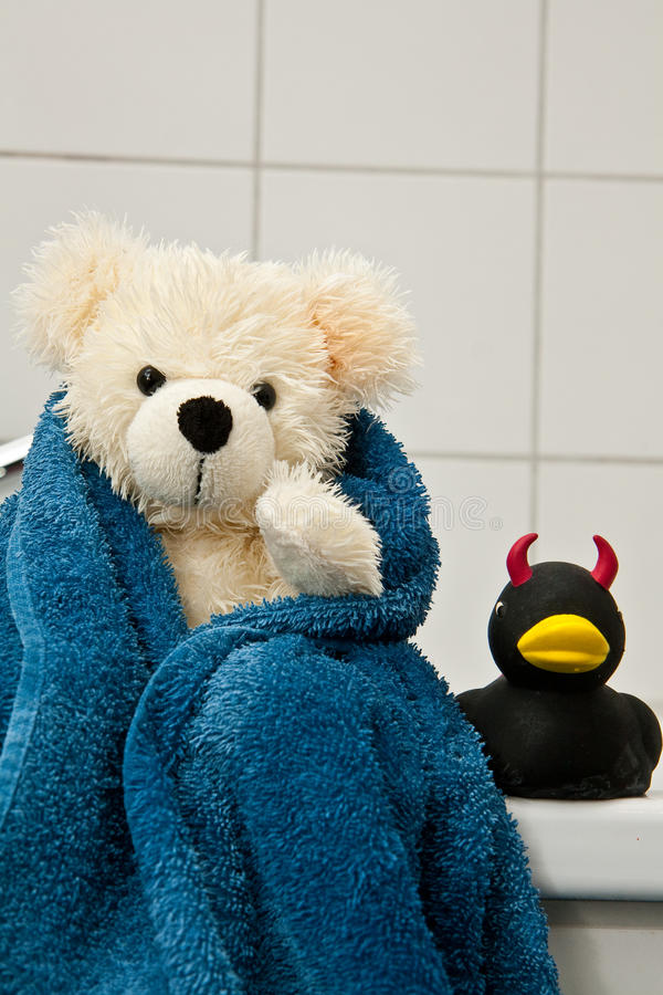 Teddy taking a bath stock images