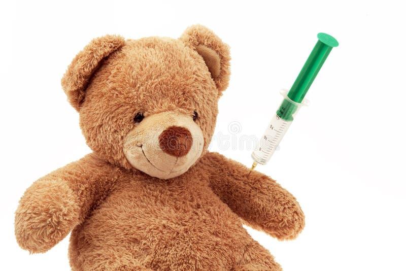 Teddybär mit Einspritzung stockfotos