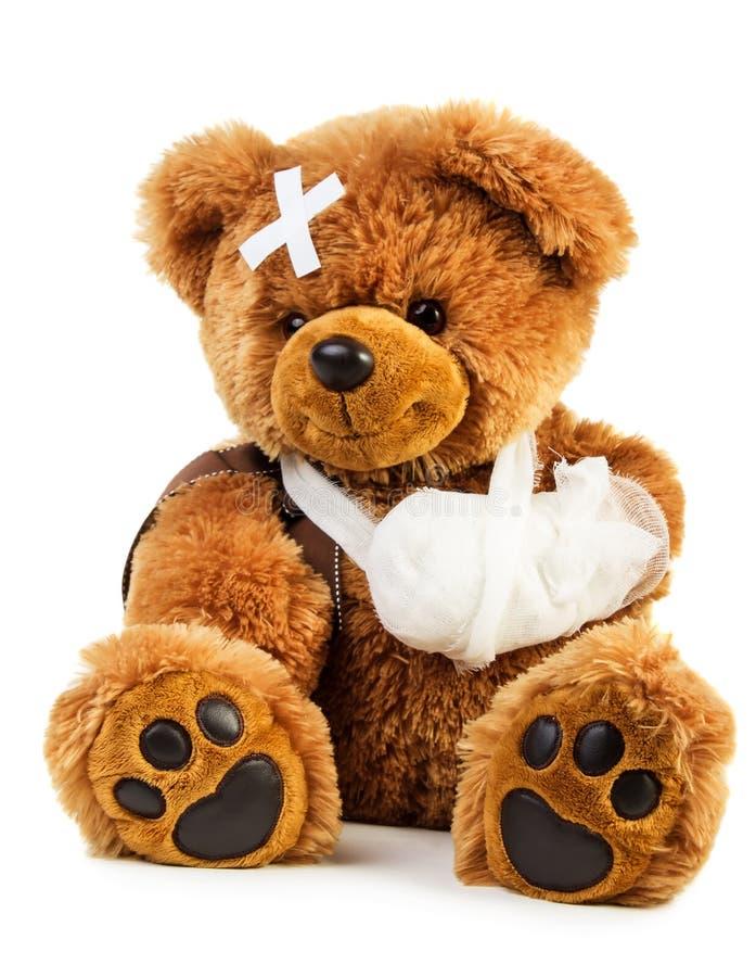 Teddybär mit Verband stockfoto