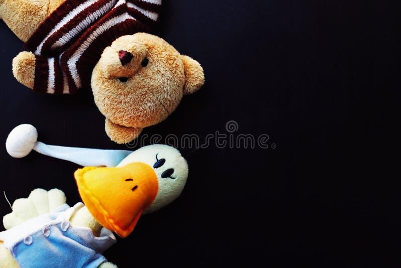 Teddybär und angefüllte Ente stockfoto