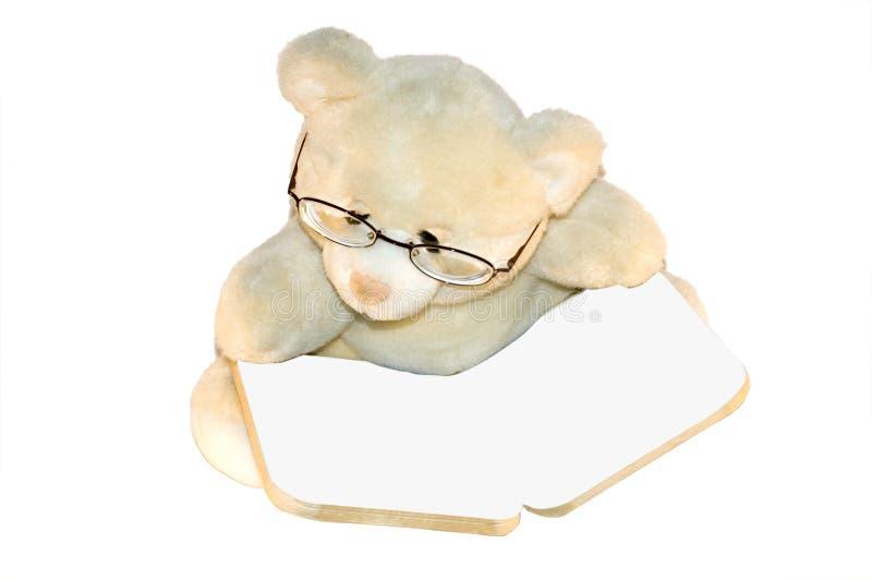 Teddybear阅读书 免版税图库摄影