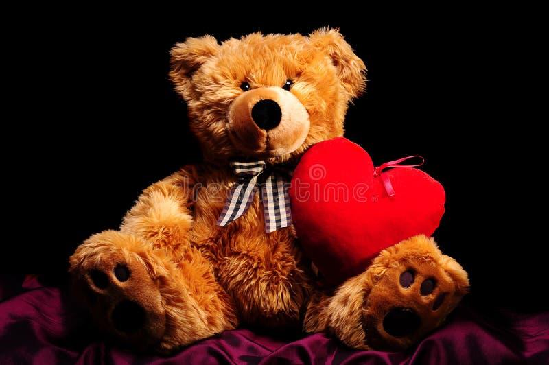 Teddybear met hart stock afbeelding