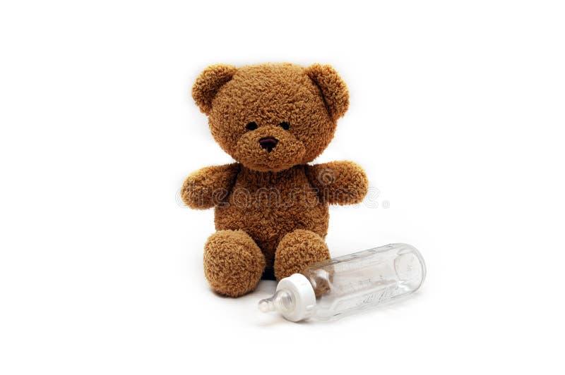 Teddybeer en fles   stock afbeeldingen