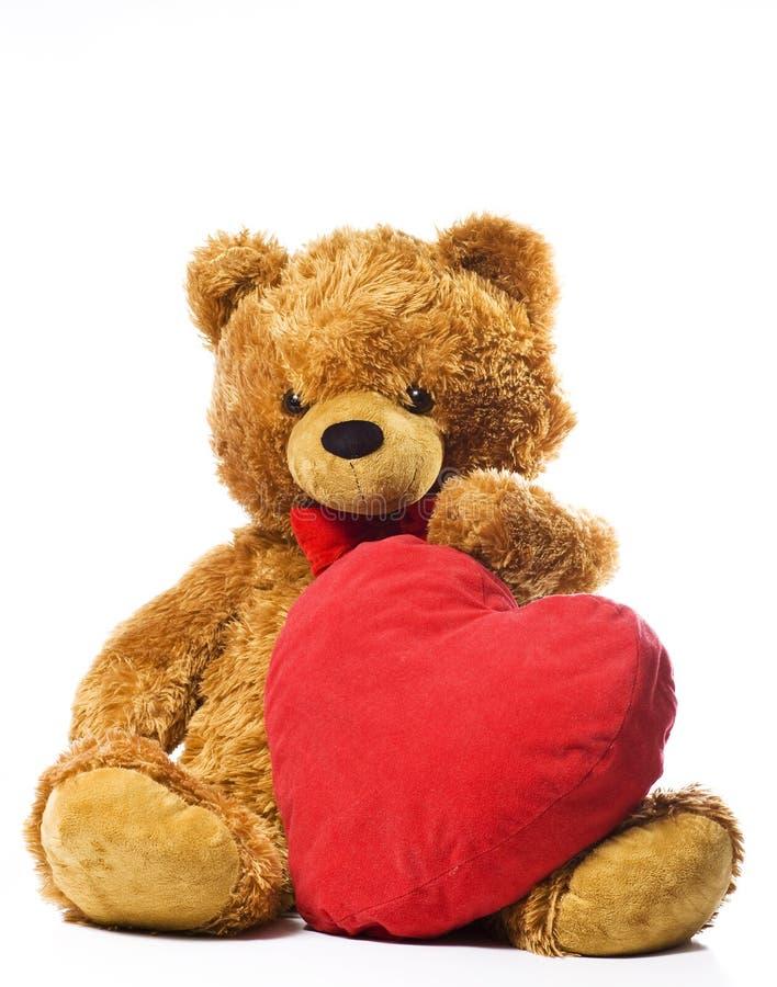 Teddybeer en rood hart royalty-vrije stock afbeeldingen