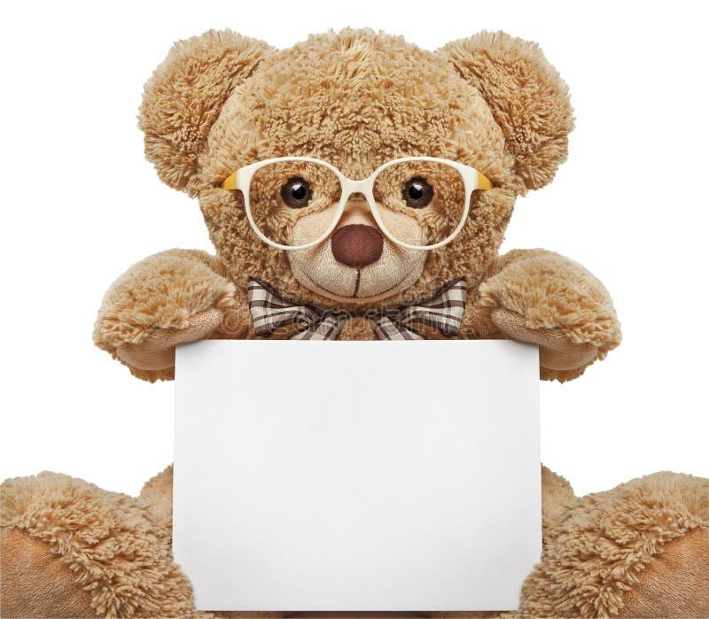 Teddybeer in glazen met lege banner stock foto's
