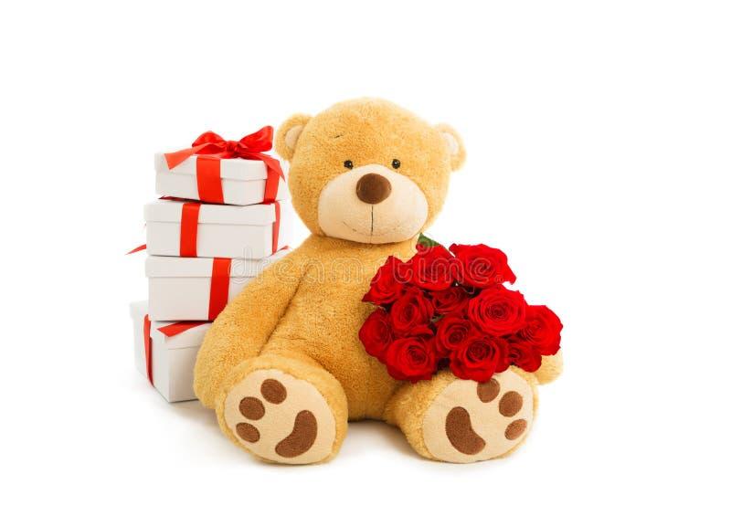 Teddybeer met giftdoos en boeket van rode rozen royalty-vrije stock afbeelding