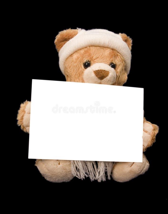 Teddybeer met lege kaart stock foto