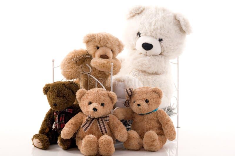 Teddyberen en retro bed royalty-vrije stock foto