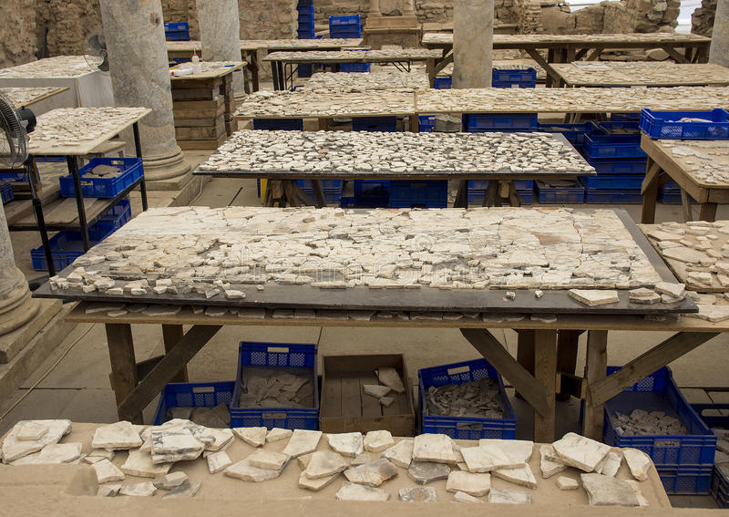 Tedious work of reconstructing terrace houses, Ephesus. Tables with many small pieces highlight the tedious work of reconstructing the terrace houses at the stock photography