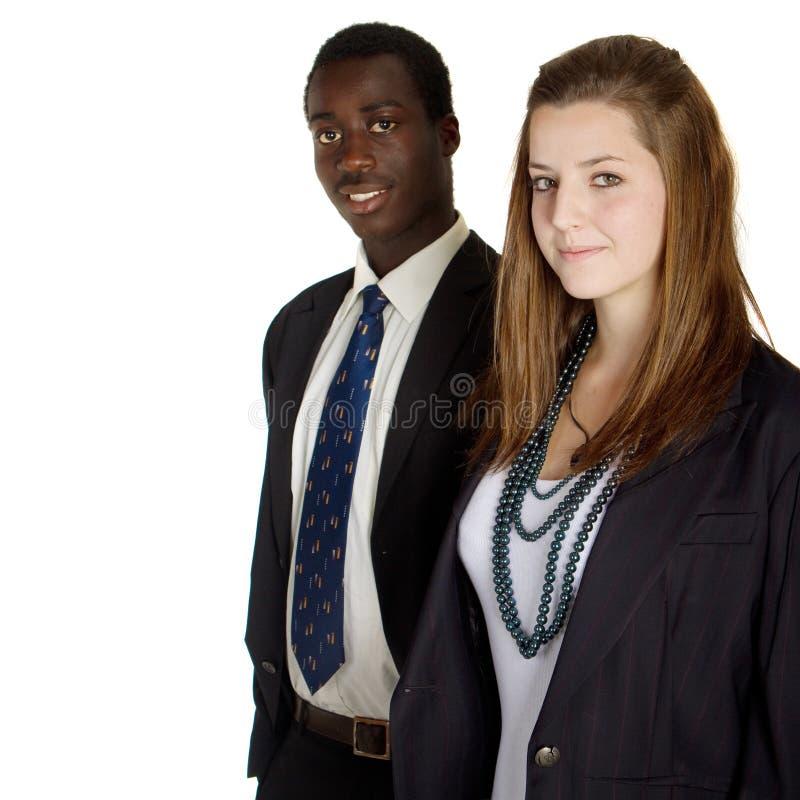 Teeangers inter-raciais novos do negócio fotografia de stock royalty free