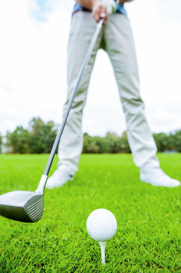 Teeing off. royalty free stock image