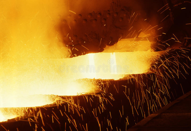 Teeming liquid steel stock photos