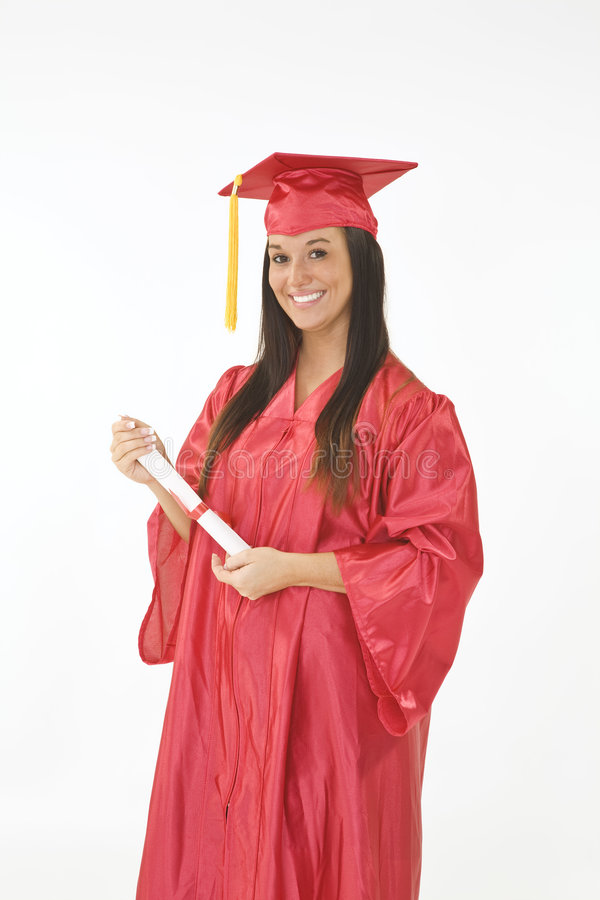 Beautiful Caucasian woman wearing a red graduation gown holding diploma royalty free stock photography