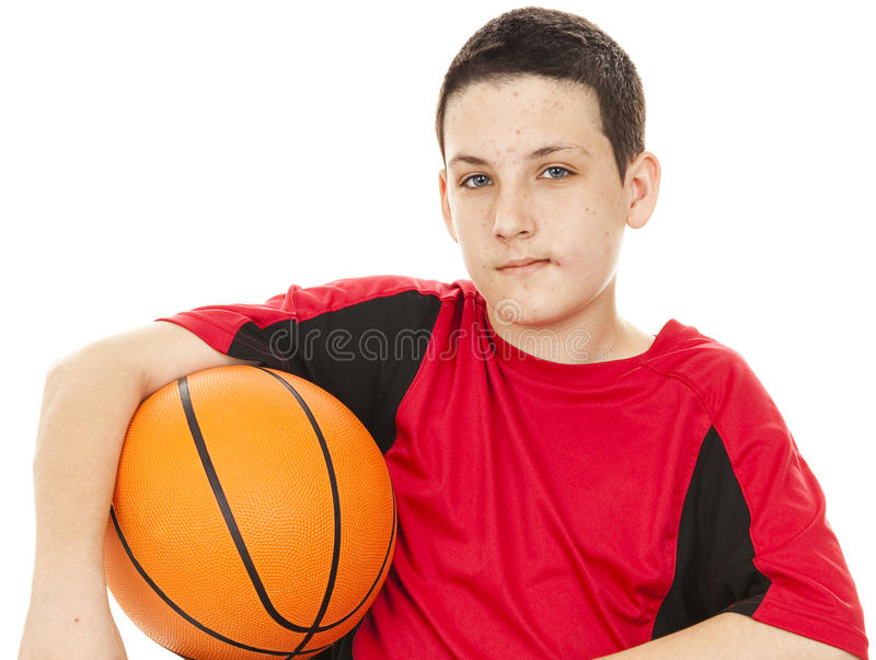 Teen With Acne. Handsome teenage boy suffers from acne. White background royalty free stock image