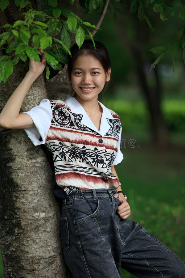 Download Teen Age  Standing Near Tree In The Park With Ni Stock Photo - Image: 26428232