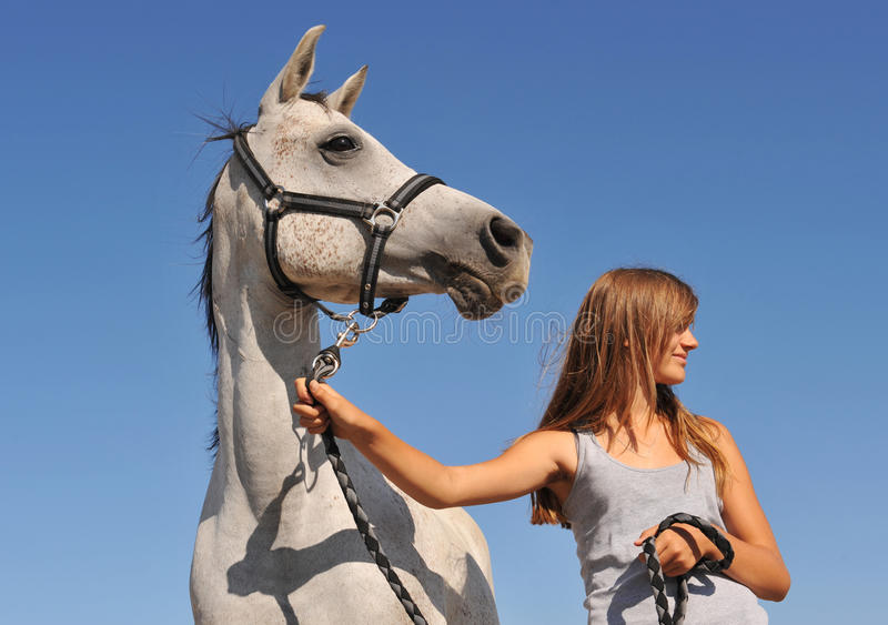 Teen and arabian horse royalty free stock images