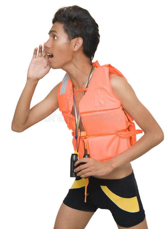 Teen Asian lifeguard yelling. Young Asian male teenage lifeguard in red life jacket firmly holding binoculars and yelling or shouting at imminent danger with his royalty free stock images