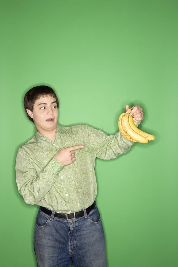 teen bananpojkeholding fotografering för bildbyråer
