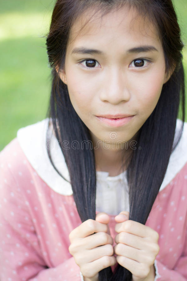 Teen beautiful girl Dress pink happy and relax On Park stock image