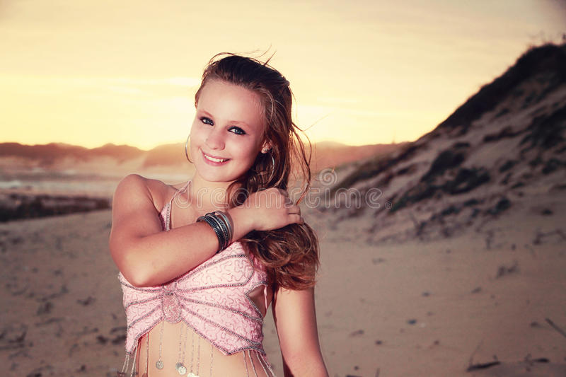 Download Teen Belly Dancer Looking Shy On The Beach Stock Photo - Image: 37371682