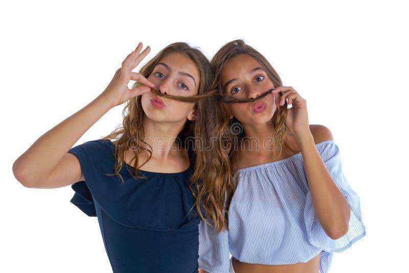 Teen best friends girls fun hair moustache royalty free stock photo
