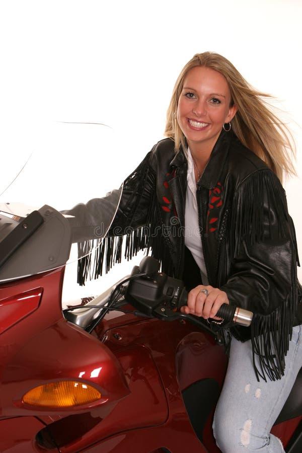 teen blåsigt för hårmotorcykel royaltyfri foto