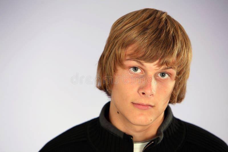 teen blond pojke royaltyfri fotografi