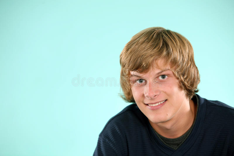 teen blond pojke royaltyfri foto
