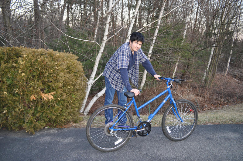 Teen with Blue Bike stock photos