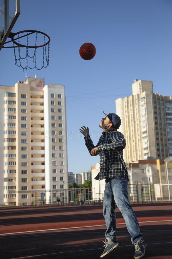 Teen boy basketball player in action in a basketball court royalty free stock photo