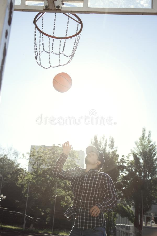 Teen boy basketball player in action in a basketball court royalty free stock photos
