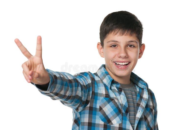 Teen boy celebrates victory royalty free stock photos