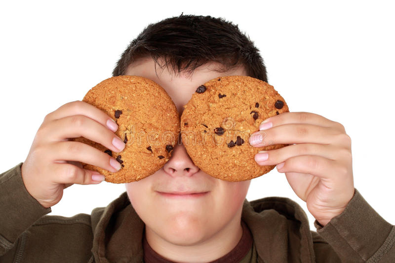 Teen boy with cookies stock photography