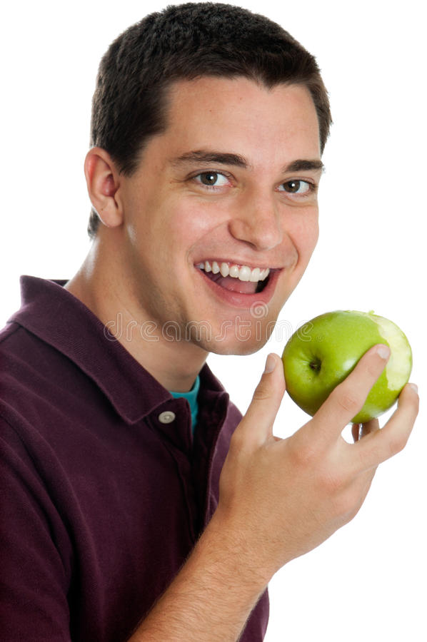 Download Teen boy eating an apple stock image. Image of smiling - 23246763