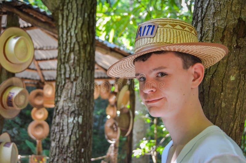 Teen Boy with a Hat - Labadee, Haiti stock photo