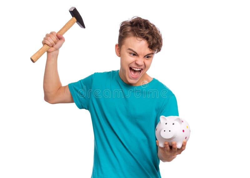 Teen boy holding piggy bank royalty free stock photos