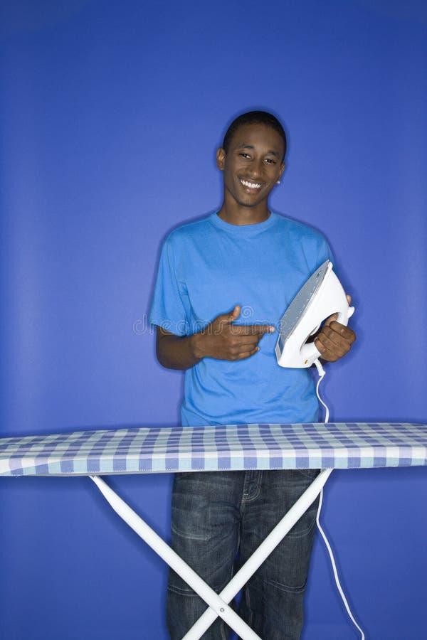 Teen boy with iron. royalty free stock photo