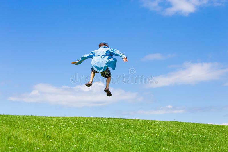 Teen boy jumping royalty free stock images