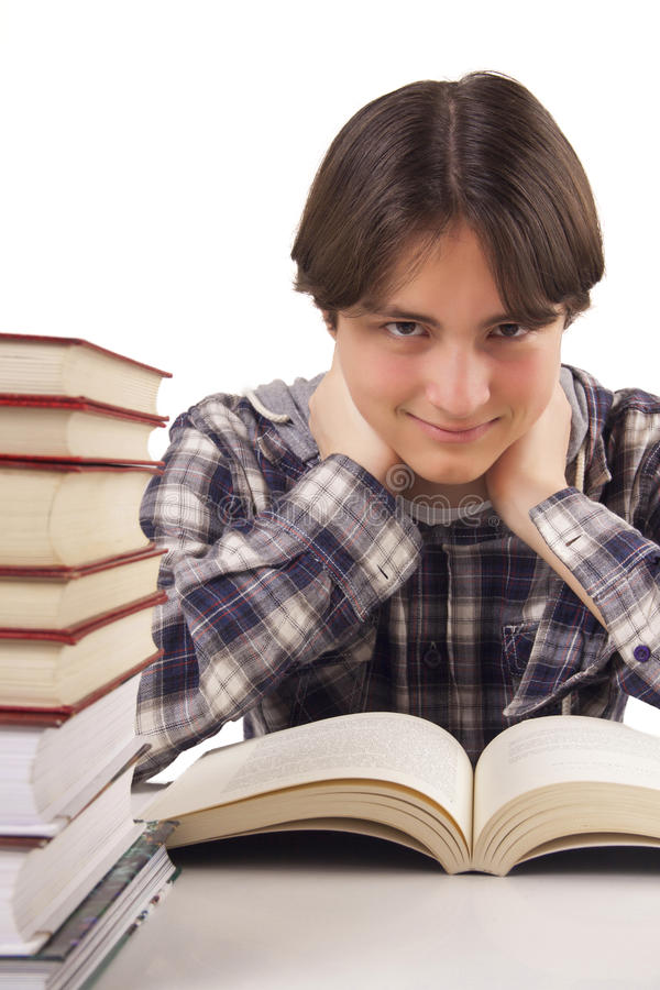 Download Teen Boy Learning At The Desk Stock Image - Image: 29942111