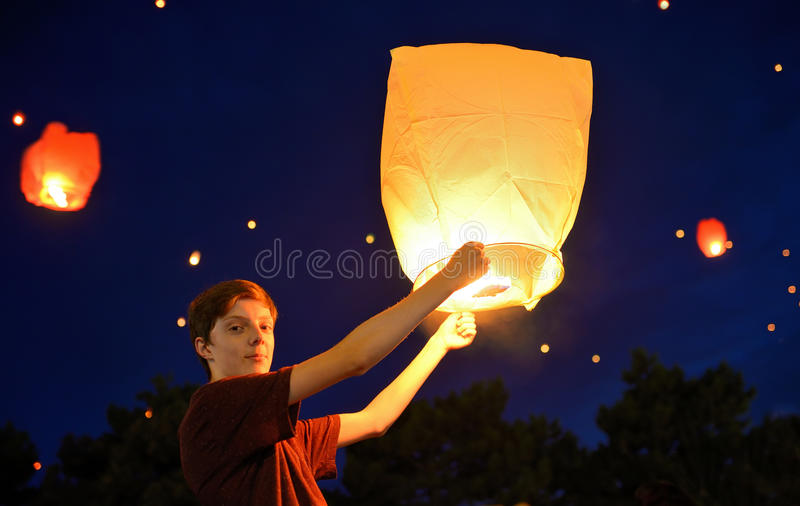 Teen boy with paper lantern royalty free stock image