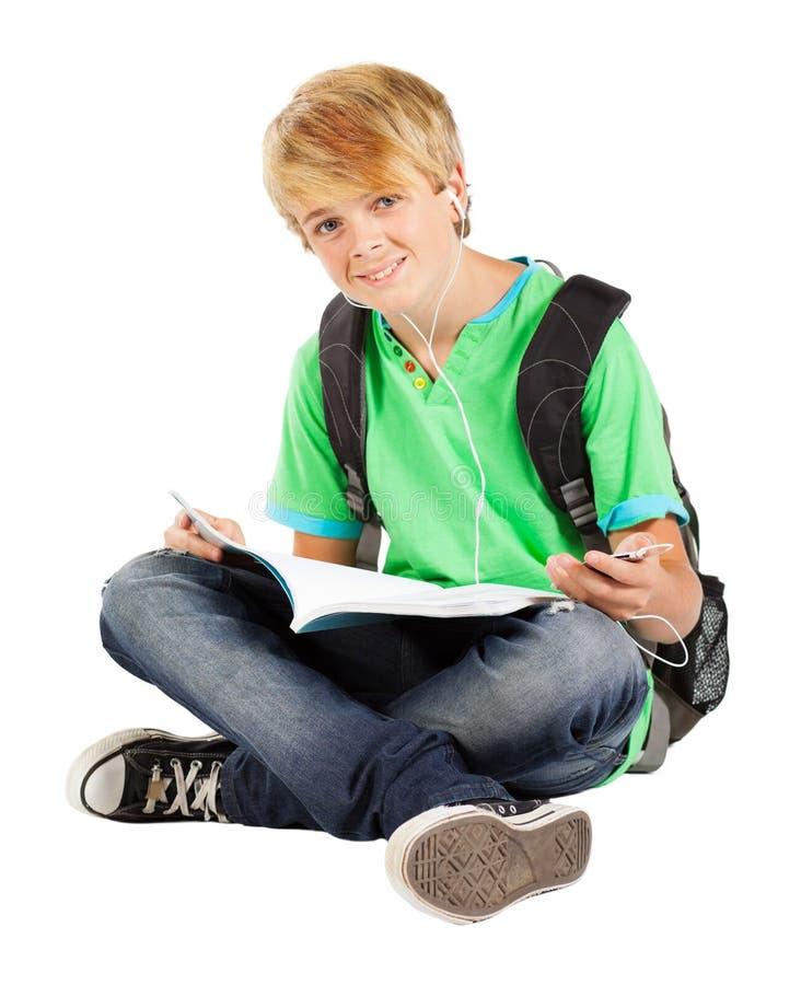 Teen boy reading stock image