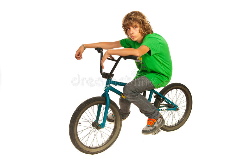 Teen boy resting on bike